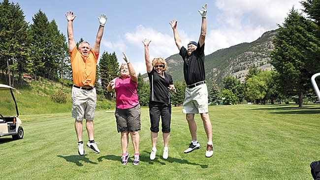 A group of golfers seem to enjoy their time out on the course during the 2011 edition of the Giving Back Golf Tournament